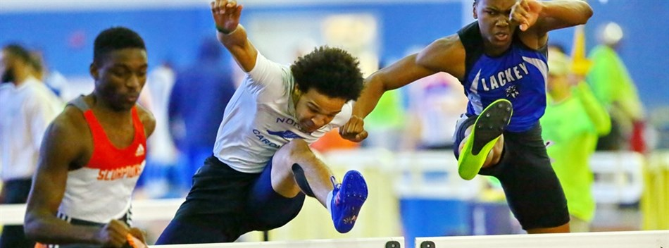 Male hurdlers race against one another during the 2017 Class 2A & 1A Indoor Track State Meets.