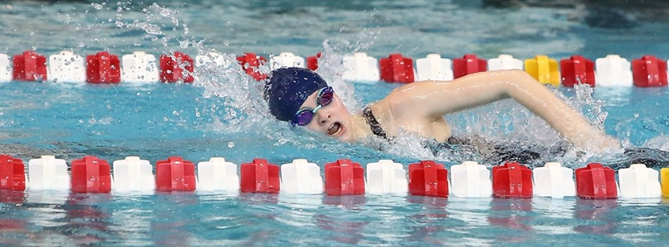 A female competes in a freestyle race at the 2019 Class 4A/3A State Meet.
